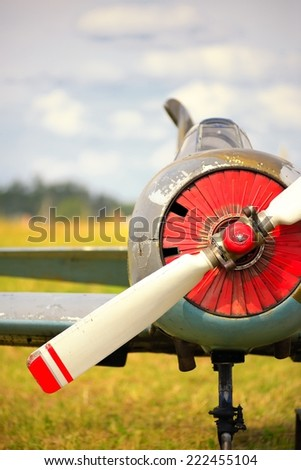 View on propeller on old russian airplane on green grass - stock photo