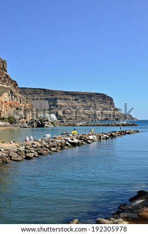 View on Puerto de Mogan bay, Gran Canaria. It is preferable resort of island with public beach, shopping facilities and restaurants.The most popular tourist destination all the year. - stock photo