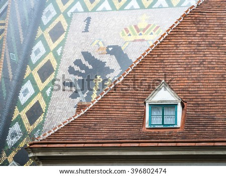 View on roofs of old town house and St. Stephen cathedral. Scene from Vienna, Austria. Europe travel. - stock photo