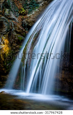 View on run water of mountain waterfall - stock photo