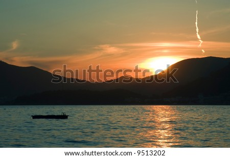View on sea and mountains at sunset - stock photo
