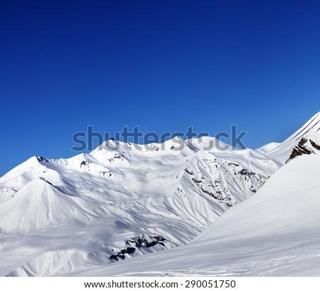View on ski slope and beautiful mountains at sun day. Ski resort Gudauri. Caucasus Mountains, Georgia. - stock photo