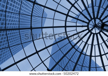 View on skyscrapers through glass roof.