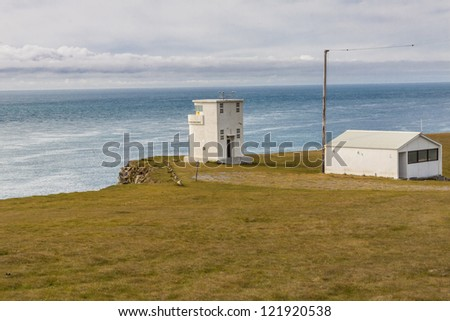 View on small white light house on Latrabjarg - Iceland. - stock photo