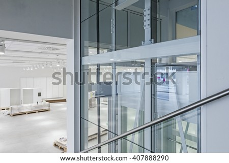 "View on staircase and glass elevator in a modern business center. Shopping center ""AVIV PARK"" in Zrenjanin, Vojvodina, Serbia, 11.09.2015."