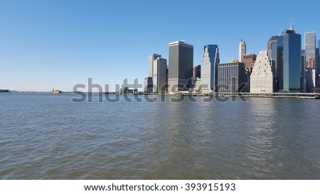 View on Statue of Liberty and Manhattan, NYC, USA.
