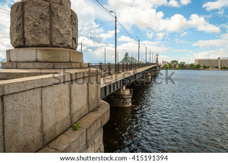 View on stone bridge called Akmens over Daugava river in Riga - stock photo