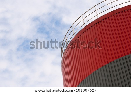 view on storage tank against sky with clouds