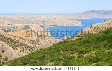 "View on summer rocky coastline of ""Sudak"" Town (Crimea, Ukraine)"