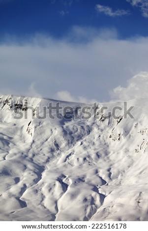 View on sunlight off-piste slope. Caucasus Mountains, Georgia, ski resort Gudauri. - stock photo