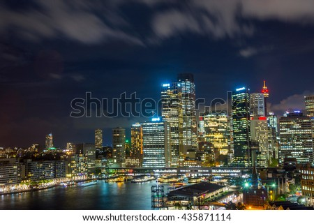 View on Sydney downtown at Circular quay with ferry terminal at night - stock photo