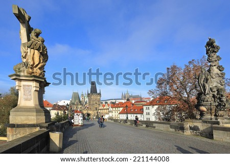 View on the autumn Prague Castle with St. Nicholas' Cathedral from Charles Bridge, Czech Republic - stock photo