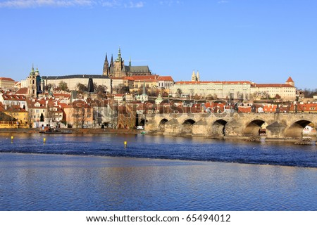 View on the autumn Prague gothic Castle with the Charles Bridge