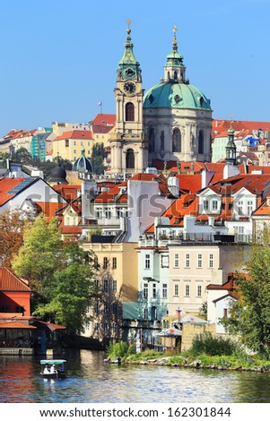 View on the autumn Prague St. Nicholas' Cathedral, Czech Republic - stock photo