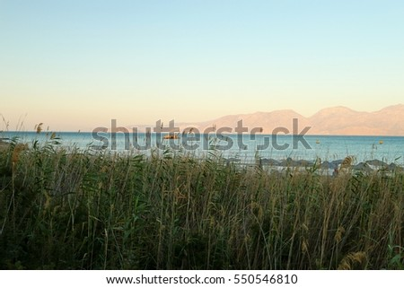 VIEW ON THE BAY OF MIRABELLO NEAR AGIOS NIKOLAOS AT SUNSET , CRETE GREECE