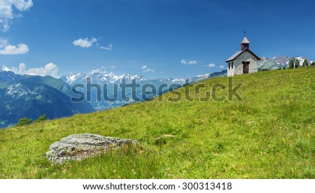 View on the chappel and the meadow near Grossglockner mountain in Hohe Tauern national park,Austria - stock photo