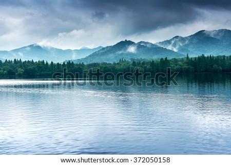 View on the enchanting West Lake, Hangzhou, China  - stock photo