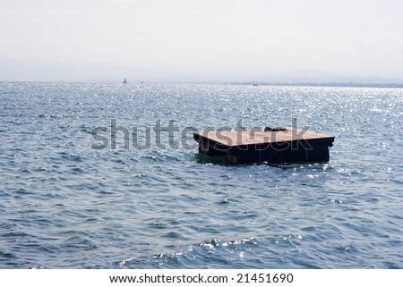 view on the lake and floating wooden pier