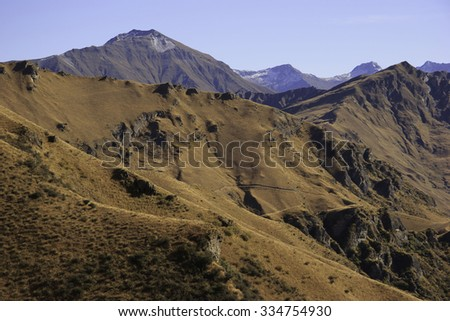 View on the mountains near Queenstown taken from the Skippers Canyon road, Queenstown, South Island, New Zealand - stock photo