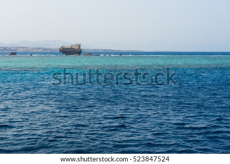 View on the old broken ship in the beautiful blue sea