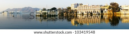 View on the Pichola lake and Palas in Udajpur, India. - stock photo