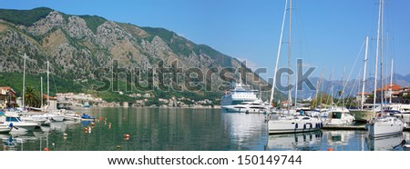 View on the port of Kotor with cruise ship and boats - stock photo