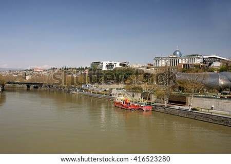 View on the river Kura, Presidential Administration and park of Rike from the Bridge of Peace, Tbilisi, Georgia - stock photo