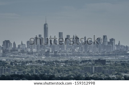 View on the skyline of Lower Manhattan from Eagle Rock Park, with the forests of New Jersey in the foreground - stock photo