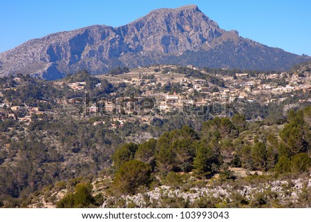 View on the Spanish village � Galilea, located on the mountains of Majorca. Rocks, green forest and blue sky.