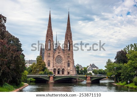 View on the St. Paul Church from the Ill river in Strasbourg, Alsace, France - stock photo