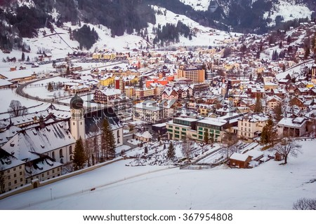 View on the swiss village Engelberg in the winter with snow covering the entire scenery - stock photo