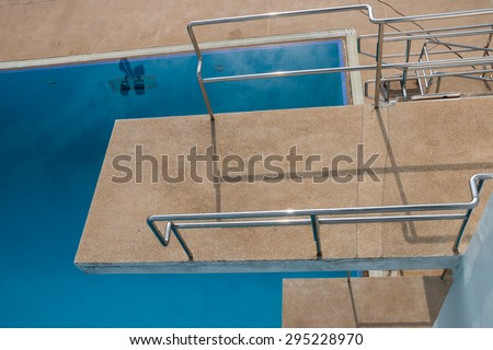 View on the top of diving platform at a swimming pool  - stock photo
