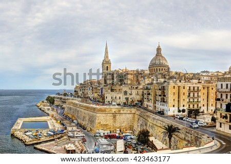 View on the Valletta city with its historic cityscape and sea and the St. Pauls Cathedral