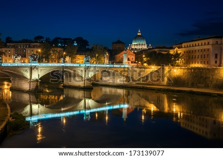 View on Tiber and St Peter's Basilica with the Bridge of Angels.