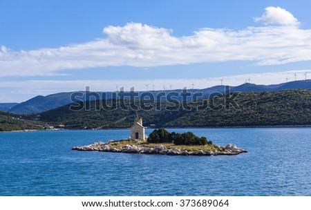 View on tiny island with the belonging church on it, Croatia.