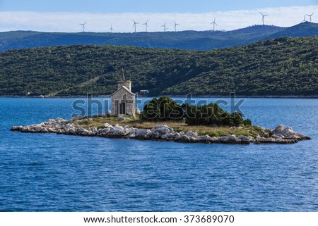 View on tiny island with the belonging church on it, Croatia. - stock photo