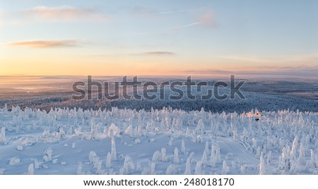 View on top of a hill at lapland Finland during sunrise. - stock photo