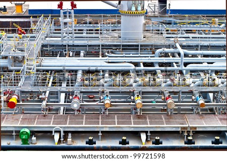 View on top of a vessel ship deck with industrial storage - stock photo