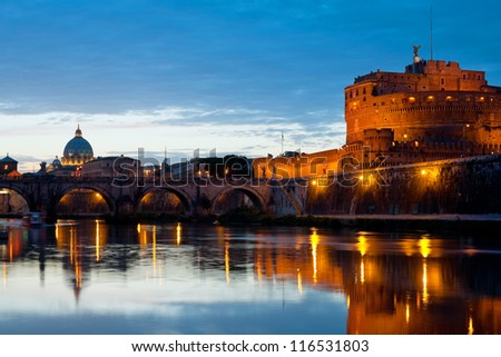 View on Vatican and Castle Sant' Angelo over the Tiber river at night.