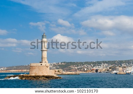 View on venetian lighthouse and harbour in Chania. Crete. Greece - stock photo