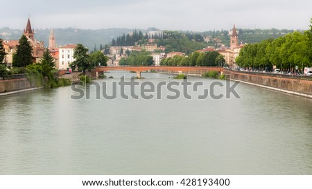 View on Verona city center from the bridge on Adige river - stock photo
