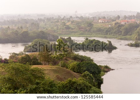 View on Victoria Nile River with several islands at dawn against morning mist background. Jinja, Uganda, Eastern Africa. - stock photo