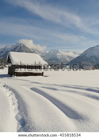 View on village in mountains - stock photo