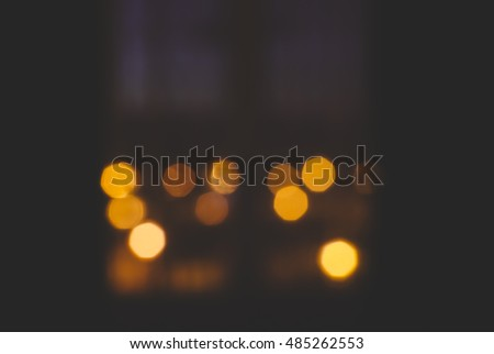 View on window with bokeh of the night city
