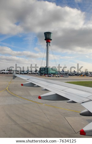 view on wing and control tower after landing at heathrow airport, london, UK - stock photo
