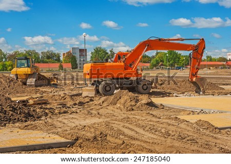 view on work of excavator on construction site - stock photo