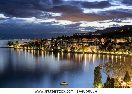 View onto surrounding buildings in Montreux by night - stock photo