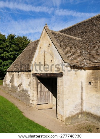 View ot the Old Stone Tithe Barn in the Historic Town of Bradford on Avon in Wiltshire England - stock photo