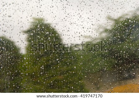 view out wet car windows on a rainy day - stock photo