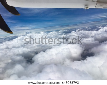 View outside of airplane window and cloud